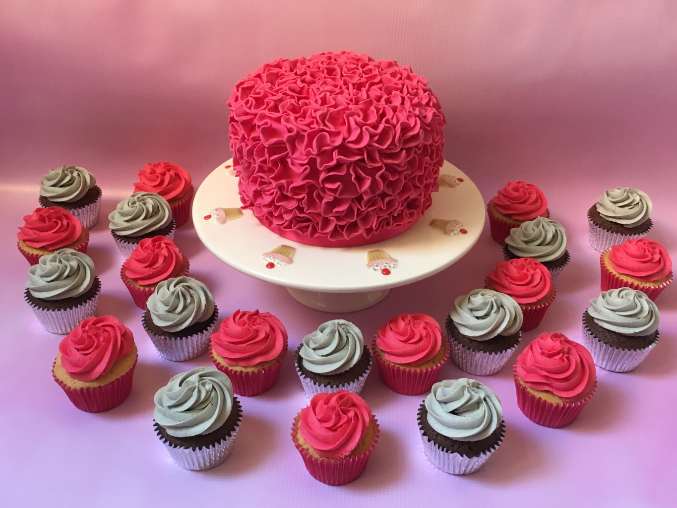 Pink-ruffle-cake-with-matching-pink-and-silver-cupcakes
