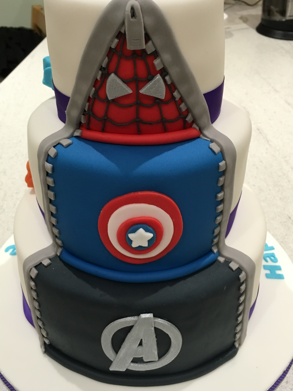 Superhero-reveal-cake