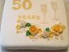 Golden-wedding-anniversary-champagne-glasses-cake